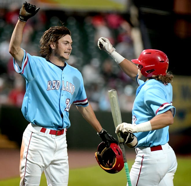 Red Land's Benny Montgomery, left, celebrates with Cole Wagner after Wagner scored against Manheim Central in a PIAA Class 5-A baseball semifinal at PeoplesBank Park Monday, June 14, 2021. Red Land went on to win 8-0. Bill Kalina photo
