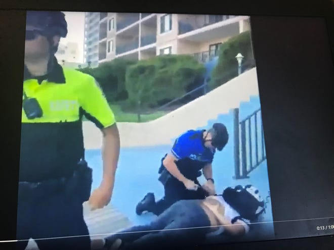 This image shows an Ocean City officer handcuffing an 18-year-old after a Taser was used on him during a boardwalk arrest captured in viral video on Sunday, June 6, 2021.