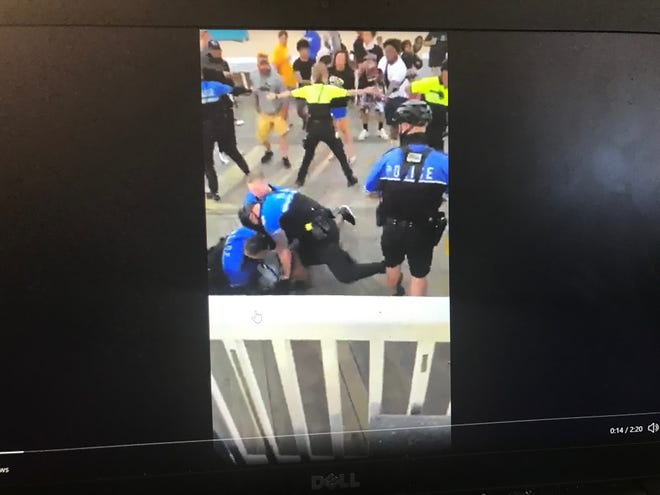 This image shows an Ocean City police officer striking a 19-year-old during a boardwalk arrest captured in viral video on Saturday, June 12, 2021.