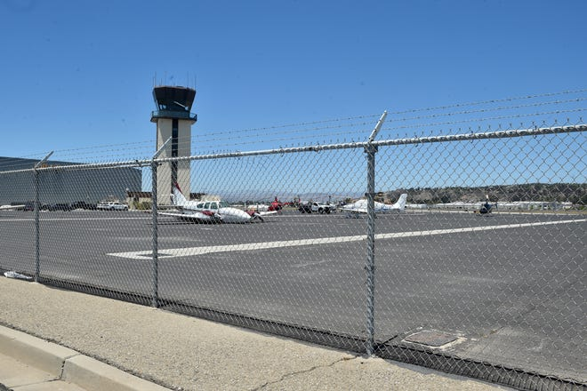 The aircraft control tower sits in the background at the county-run Camarillo Airport in June. The county has named a new airport director for Camarillo and its counterpart Oxnard Airport.