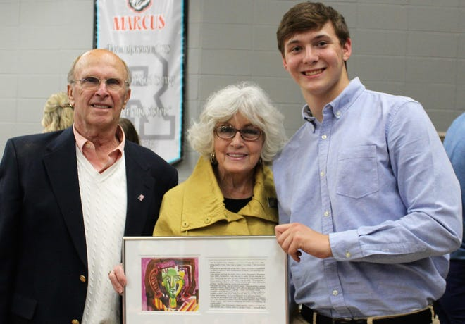 Ron and Mary Bucci presents Ethan Phillips with the $500 Ronna Bucci and Dr. Charles Dietz Art Scholarship during an awards ceremony at Bishop Rosecrans High School.