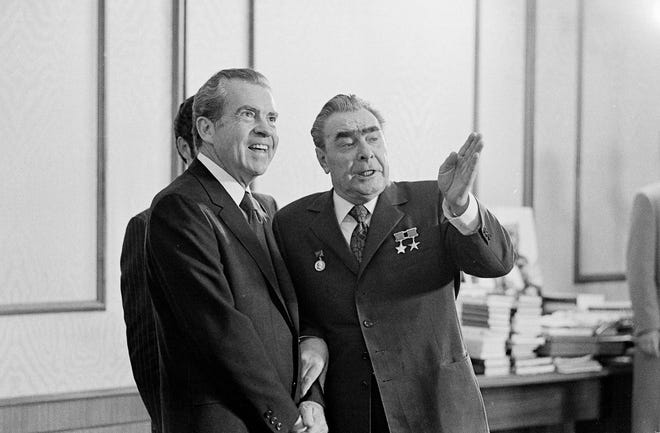 Communist Party leader Leonid Brezhnev, right, makes a point in conversation with President Richard Nixon during a Kremlin reception in Moscow, June 27, 1974.
