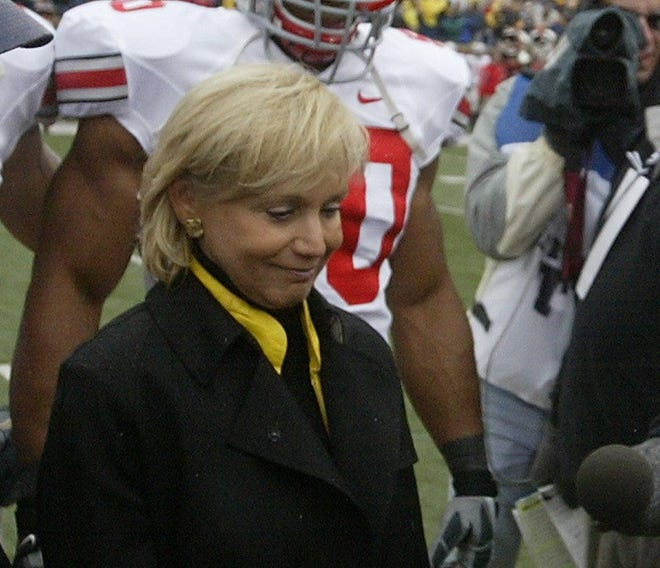 Cathy Schembechler participates in the opening coin toss for the Michigan-Ohio State football game on Nov. 17, 2007, at Michigan Stadium.