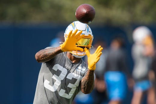 Los Angeles Chargers free safety Derwin James (33) works on a drill during NFL football practice Tuesday, June 15, 2021, in Costa Mesa, Calif.