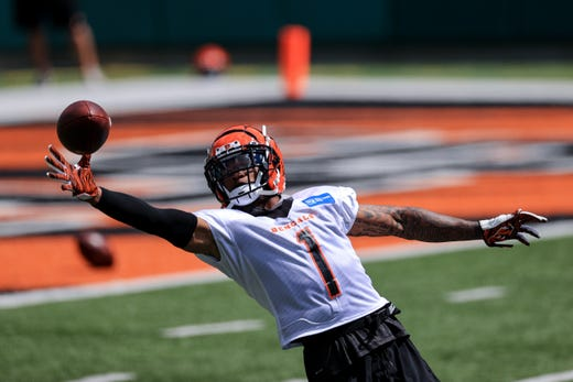 Cincinnati Bengals wide receiver Ja'Marr Chase makes a catch as he runs a drill during an NFL football minicamp practice in Cincinnati, Tuesday, June 15, 2021.