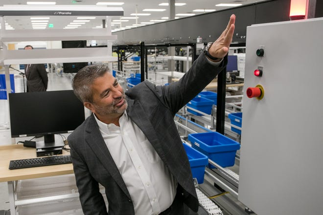 Joe Cacchione, executive vice president of Ascension, checks out the prescription fulfillment line at the new Ascension Rx Pharmacy Services Center on Tuesday.