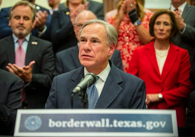 """Gov. Greg Abbott speaks during a June 16 news conference about his plan for Texas to build a border wall and provide $250 million in state money as a """"down payment."""""""