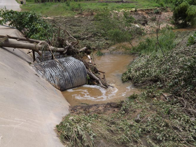 In this 2015 file photo, a swollen creek washed out a culvert in Bastrop. On Monday, the Bastrop County Commissioners Court awarded a construction contract for a culvert improvement project in Stony Point, a neighborhood on the county's westside.