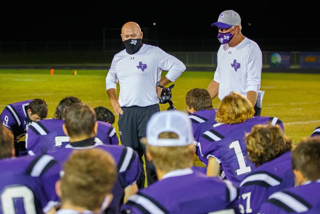 Thrall head coach Ricky Porter (left) talks to his team after a game versus Snook last fall. Porter died Tuesday after a battle with cancer.
