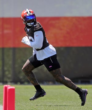 Cleveland Browns wide receiver Odell Beckham Jr. (13) jogs downfield during an NFL football practice at the team's training facility, Wednesday, June 16, 2021, in Berea, Ohio. [Jeff Lange / Akron Beacon Journal]
