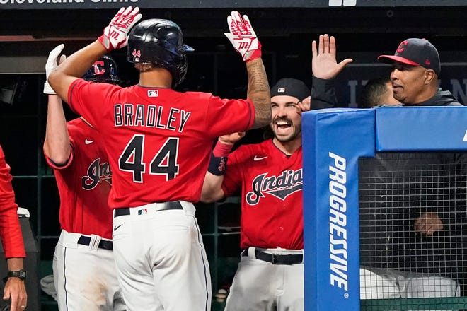 Cleveland's Bobby Bradley is congratulated by teammates after hitting a solo home run during the seventh inning of a win over Baltimore, Tuesday, June 15, 2021, in Cleveland. (AP Photo/Tony Dejak)