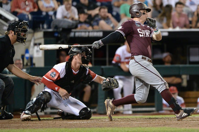 Mississippi State's Tanner Allen hits an RBI single against Louisville during the 2019 College World Series. This year, Allen is one of five Bulldogs who have hit double-digit home runs. That hasn't happened in Starkville since 1998.