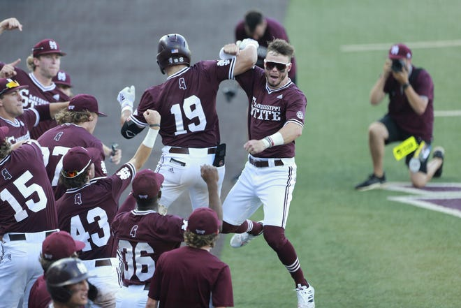 Mississippi State's Logan Tanner, center, and Tanner Allen, right, celebrate after Allen's second-inning home run in Monday's 11-7 win over Notre Dame in the third game of the Starkville Super Regional.