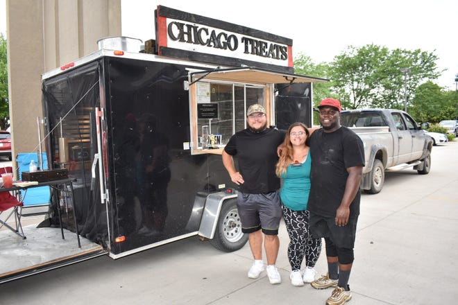 Chicago Treats food truck owner Cle Reed, right, poses with his wife Krista Flowers and brother-in-law David Flowers.