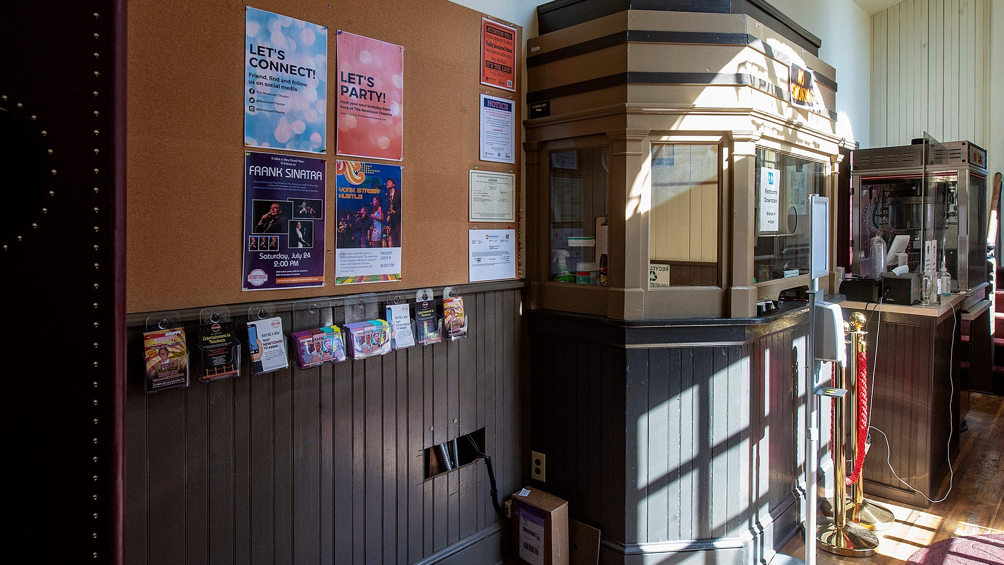 Ticket booth and refreshment booth inside the main entrance of the Newtown Theater.