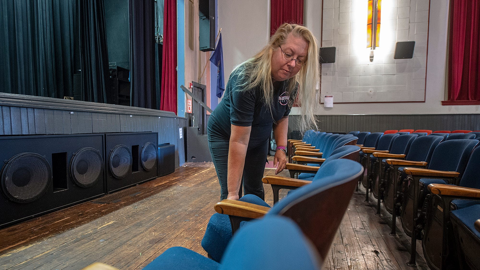 Newtown Theater director Carol Wasielewski of Trenton rearranged the rows of some of the 300 seats, dating from 1935, on Wednesday.