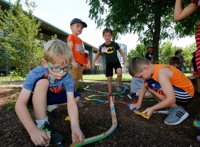 From left, Clint Welch, 6, of Bangs, Logan Wright, 5, of Brownwood and twins Drake and Wyatt Stephenson, 6, of Comanche, are among campers building a model railroad outside the Lehnis Railroad Museum Wednesday afternoon.
