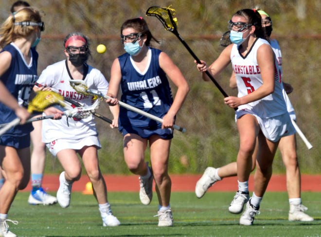 Emerson Pekarcik of Nantucket  attempts to control the ball pressured by Finley Crosby (right) and Heather Hanson of Barnstable in May.