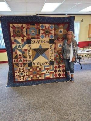 The Piecers of the Heartland quilt guild presented their 2020 Raffle Quilt at their June 14 meeting to the winner, Kim Utsinger, Canton.