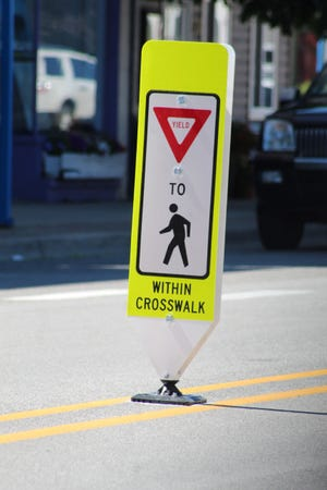 Four new signs have been installed on the centerline of Main Street, near some of the major crosswalks in town, to alert motorists of the crosswalks and potential of pedestrians being in the walkway.