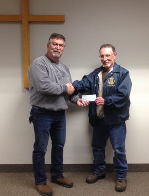 Rotary Club of Cheboygan Treasurer Bill Ahrenberg (right) recently presented Roman Hank, business manager of the Salvation Army of Cheboygan, with a donation for $1,200 from the Rotary Club to help purchase a new refrigerator and freezer.