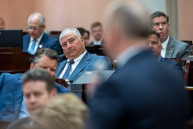 Rep. Larry Householder listens as Rep. Brian Steward introduces a resolution to expel Householder during a session of the Ohio House at the Ohio Statehouse in Columbus on Wednesday, June 16, 2021. The resolution passed 75-21.