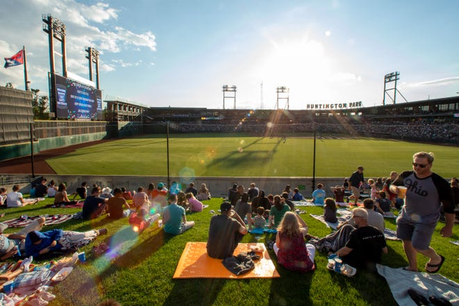 Fans watch the Columbus Clippers play the Toledo Mud Hens in a game the home team would win 5-4 at Huntington Park on Tuesday. The game was the first home game of the season to allow full capacity.