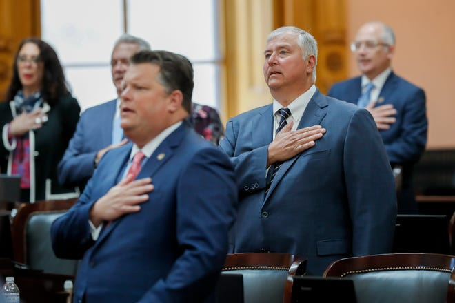Rep. Larry Householder stands for the Pledge of Allegiance during a session of the Ohio House at the Ohio Statehouse in Columbus on Wednesday, June 16, 2021. Householder was expelled from his duties as a representative later in the session.