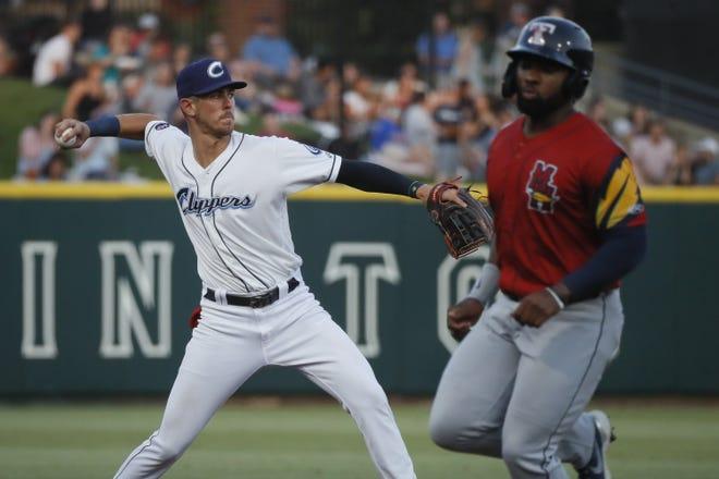 Columbus Clippers third baseman Nolan Jones (10) fields a ball against the Toledo Mud Hens at Huntington Park on June 15.