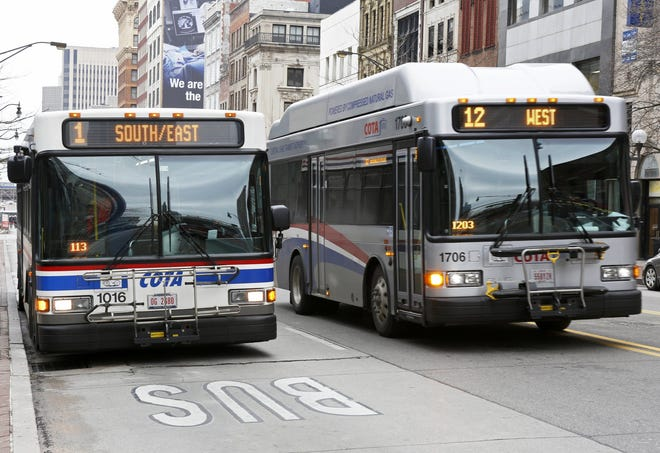 COTA buses come and go near stops along Broad and High streets in Downtown Columbus in this March 2019 photo.