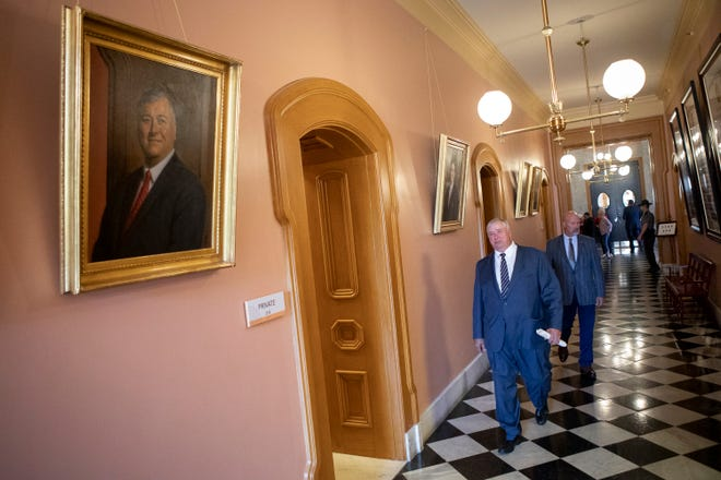 Rep. Larry Householder walks past his portrait after being expelled from the Ohio House at the Ohio Statehouse in Columbus on June 16. His son Derek was among 19 applicants to replace him.