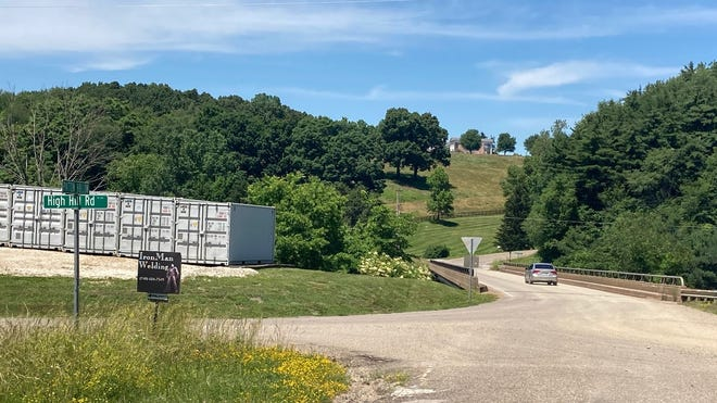Guernsey County Commissioners hosted a bid opening Wednesday for a $1.4 million project that will resurface High Hill Road and a portion of Georgetown Road that leads to the west side of Cambridge. The contract is expected to be awarded later this summer.