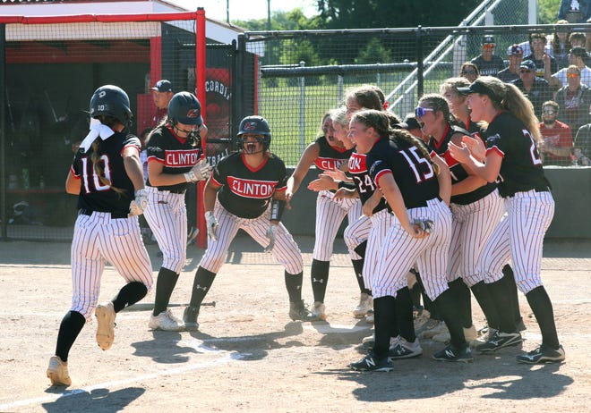 The Clinton softball team celebrates at home plate after Libbi Fair (10) hit a two-run home run in the third inning of their Division 3 state quarterfinal against Riverview Gabriel Richard. Clinton won 4-2 over the Pioneers to advance to the state semifinals on Friday at Michigan State University.