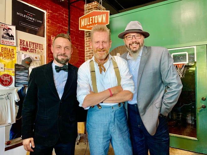 """Rory Feek, center, celebrates the release of his new album, """"Gentle Man,"""" with producers Matt Johnson, left, and Ben Isaacs, right, at Muletown Coffee's roasting facility in Columbia."""