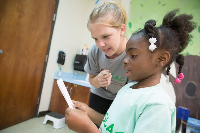 Riverside Elementary School kindergarten teacher Olivia Smith works with Takyeria Robinson, 6, during a summer reading program at the school in Columbia, Tenn., on Wednesday, June 14, 2017.