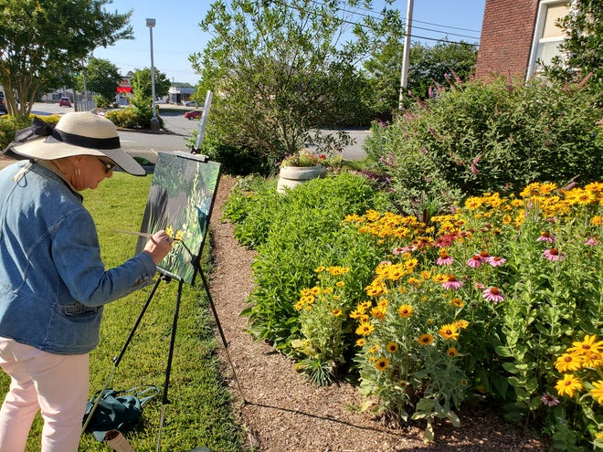 Brenda Grady, an Extension Master Gardener volunteer, works on a painting of the Master Gardeners Demonstration Garden at the Davidson County Cooperative Extension Center. The Master Gardeners are inviting artists to participate in their Art in the Garden event on Saturday.