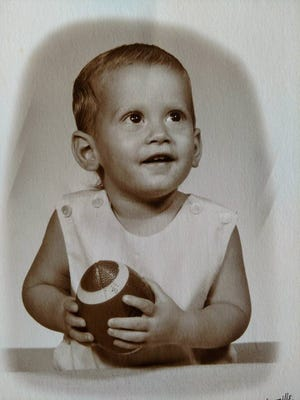 """A baby picture of Mark Burger, of Daytona Beach. Burger, now 52, was recently reunited with his biological father, Tommy Leonard, of Island Park, Idaho. """"It's overwhelming,"""" Burger said of the newly discovered relationship."""