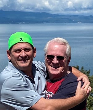Mark Burger (left) of Daytona Beach, hugs his biological dad, Tommy Leonard, of Island Park, Idaho. The two men only recently learned on their relationship to each other.