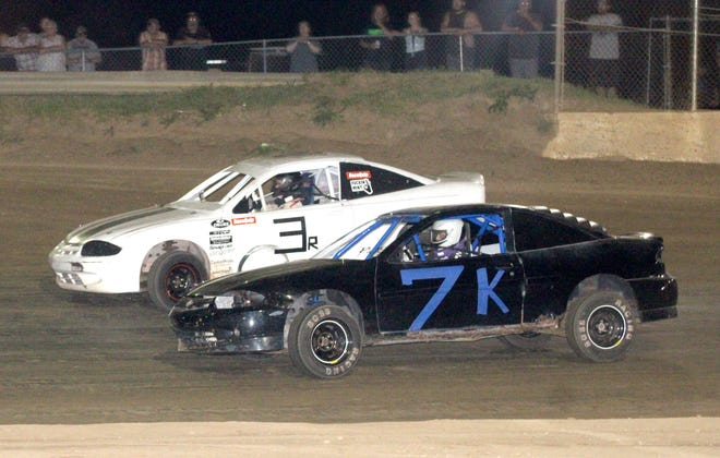 Cody Kipp (7K) and John Ruby Jr., battle side-by-side for the lead during Saturday night's front-wheel drive feature. Kipp came away with the win.