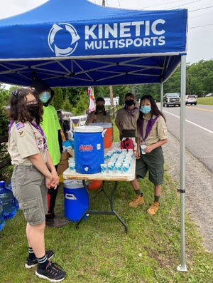 Scouts BSA Girls Troop 2619  held out cups of beverages and snacks for Poconos Triathlon runners, June 12./ Contributed image