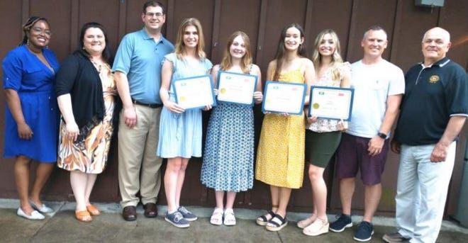 Scholarship money was recently presented by the Ellwood City Wolves Club. Pictured, from left to right, include Mahogany Thaxton of the Pittsburgh Foundation, Development Associate and Assistant to the President of CCBC Leanne Condron, Wolves Club Scholarship Chairman Jared Gibbons, scholarship recipients Molly McCommons, Makena Hall, Cheyenne Ault, and Amelia Bailey, Riverside High School Counselor Ben Huth, and Wolves Club President Mike DeOtto. Not pictured are the other scholarship recipients Haylee Anderson and Andrew Palmer.