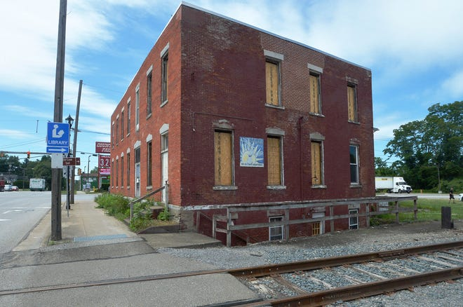 The east wall of the Girard Hotel building is shown in Girard.