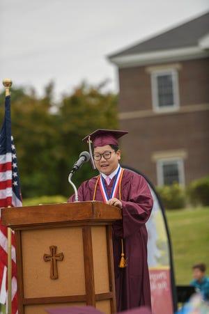 Salutatorian Hans Xu speaks at the Portsmouth Christian Academy graduation in Dover June 11, 2021.