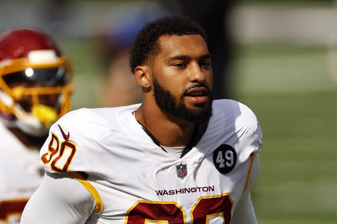 """Washington Football Team defensive end Montez Sweat, seen here walking off the field last season before a game against the New York Giants, isn't a fan of the organization trying to convince players to get vaccinated against COVID-19, saying he """"probably won't get vaccinated"""" until he has more information."""