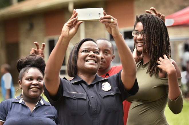 JSO assistant chief and 2023 sheriff's candidate Lakesha Burton (center) takes a selfie.