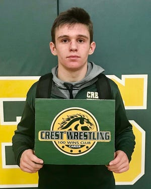 Crest's Rex Howard, shown here after earning his 100th career win earlier this spring, prevailed in the 138-pound division in the West 3A regionals.