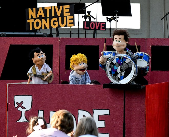 Youth members of the HOPE Puppets ministry of the First Christian Church perform a selection Saturday in Stevens Park during the Beef Empire Days Praise in the Park event. Besides the puppets, praise groups from four local churches filled the park with music for the evening event.