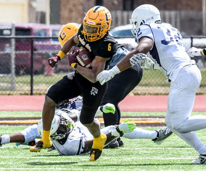 Garden City Community College running back Jordan Ford, left, breaks through an attempted tackle by Arkansas Baptist's Jordan Oglesby and picks up 30 yards on a carry in March at Bronbuster Stadium.