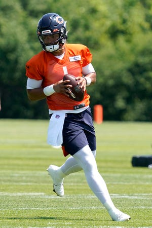 Chicago Bears quarterback Justin Fields runs during a practice in Lake Forest on Wednesday, June 9, 2021.