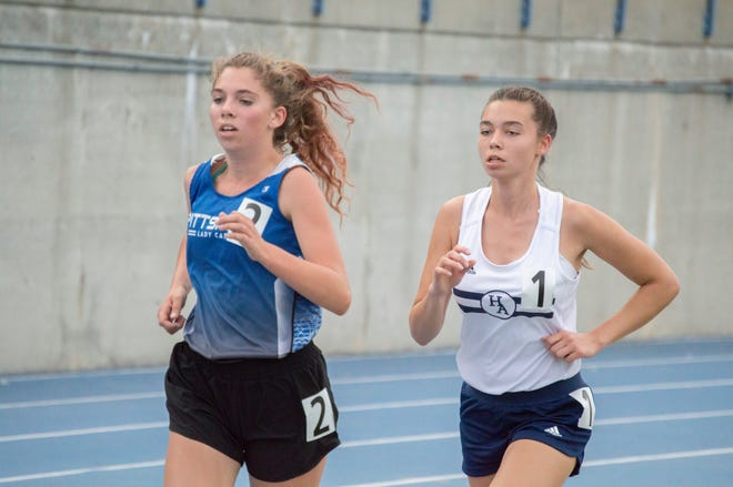 Pittsford Freshman Brooke Smith (left) and Hillsdale Academy Senior Sofia Matsukova-Kratt (right) running in the 3200 meter race at the SCAA championships.